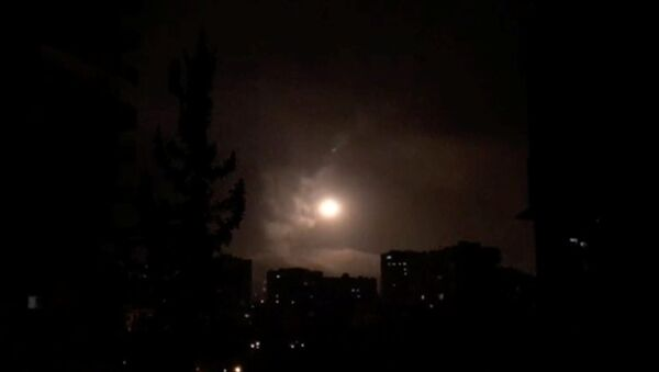 Syria air defences strike back after air strikes by U.S., British and French forces in Damascus, Syria in this still image obtained from video dated early April 14, 2018 - Sputnik International