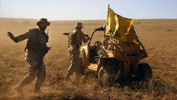 FILE - In this July 29, 2017 file photo,Hezbollah fighters stand near a four-wheel motorcycle positioned at the site where clashes erupted between Hezbollah and al-Qaida-linked fighters in Wadi al-Kheil or al-Kheil Valley in the Lebanon-Syria border - Sputnik International