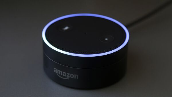 March 2, 2016 photo shows an Echo Dot in San Francisco. Amazon.com is introducing two devices, the Amazon Tap and Echo Dot, that are designed to amplify the role that its voice-controlled assistant Alexa plays in people's homes and lives - Sputnik International