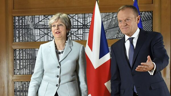 British Prime Minister Theresa May, left, walks with European Council President Donald Tusk prior to a meeting at the Europa building in Brussels on Friday, Dec. 8, 2017. - Sputnik International