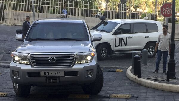 United Nations vehicles carry the team of the Organization for the Prohibition of Chemical Weapons (OPCW), arrive at hotel hours after the U.S., France and Britian launched an attack on Syrian facilities to punish President Bashar Assad for suspected chemical attack against civilians, in Damascus, Syria, Saturday, April 14, 2018 - Sputnik International