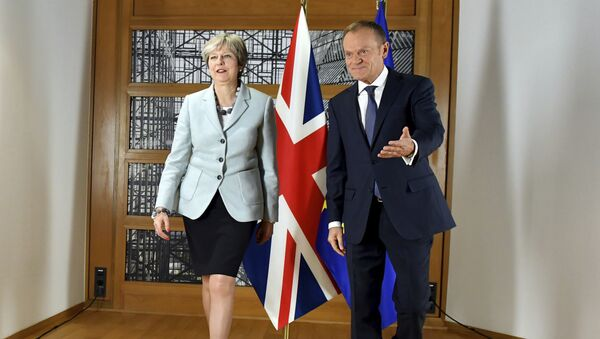 British Prime Minister Theresa May, left, walks with European Council President Donald Tusk prior to a meeting at the Europa building in Brussels on Friday, Dec. 8, 2017 - Sputnik International