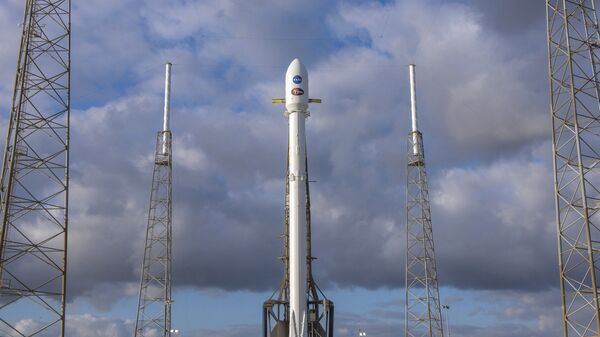 In this image released by SpaceX, NASA' s Transiting Exoplanet Survey Satellite (Tess) sits atop a SpaceX Falcon 9 rocket at Space Launch Complex 40, Monday, April 16, 2018, in Cape Canaveral, Fla. - Sputnik International