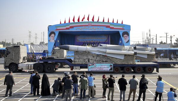 In front of the portraits of supreme leader Ayatollah Ali Khamenei, right, and the late revolutionary founder Ayatollah Khomeini, left, a missile is displayed by Iran's army during a parade marking National Army Day at the mausoleum of Khomeini, just outside Tehran, Iran, Wednesday, April 18, 2018. - Sputnik International