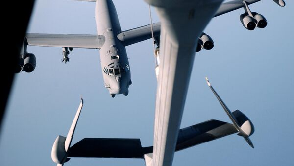 (File) A B-52 Stratofortress from the 28th Air Expeditionary Wing moving in to refuel from a KC-10 Extender, from the 60th Air Expeditionary Group 30 October on its way back to Diego Garcia after a successful bombing mission over Afghanistan - Sputnik International