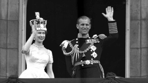 This is a June. 2, 1953 file photo of Britain's Queen Elizabeth II and Prince Philip, Duke of Edinburgh, as they wave to supporters from the balcony at Buckingham Palace, following her coronation at Westminster Abbey. London - Sputnik International
