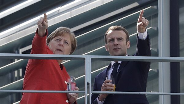 French President Emmanuel Macron, right, and German Chancellor Angela Merkel take a break on a balcony of Merkel's office after a meeting in the chancellery in Berlin, Germany, Thursday, April 19, 2018 - Sputnik International
