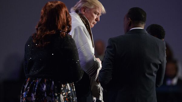 Donald Trump wears a prayer shawl during a church service - Sputnik International