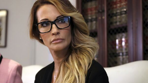 Jessica Drake listens to a question during a news conference at the office of her attorney, Gloria Allred, in Los Angeles on Saturday, Oct. 22, 2016. - Sputnik International