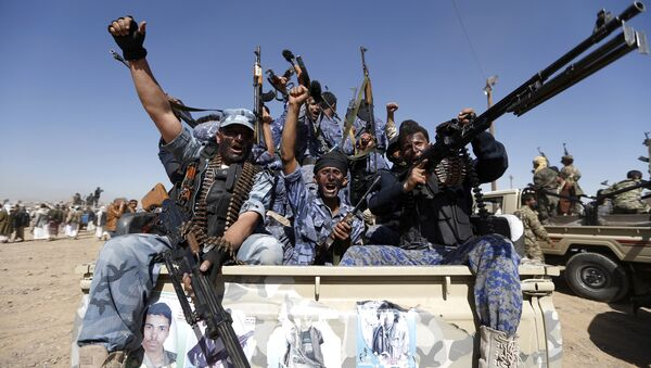 Houthi fighters chant slogans as they ride a military vehicle during a gathering in the capital Sanaa to mobilize more fighters to battlefronts to fight pro-government forces in several Yemeni cities (File) - Sputnik International