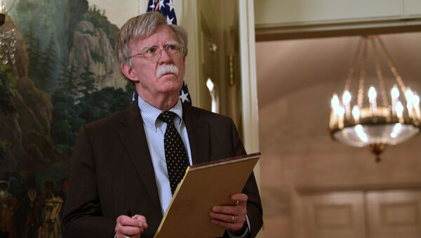 National security adviser John Bolton listens President Donald Trump speaks in the Diplomatic Reception Room of the White House on Friday, April 13, 2018, in Washington, about the United States' military response to Syria's chemical weapon attack on April 7 - Sputnik International