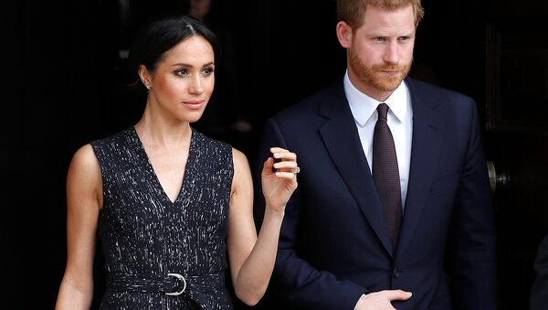 Britain's Prince Harry and his fiancee Meghan Markle leave a service at St Martin-in-The Fields to mark 25 years since Stephen Lawrence was killed in a racially motivated attack, in London, Britain, April 23, 2018 - Sputnik International
