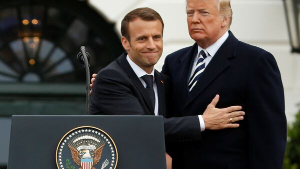 U.S. President Donald Trump and French President Emmanuel Macron attend an arrival ceremony at the White House in Washington, U.S., April 24, 2018 - Sputnik International