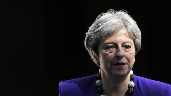 Britain's Prime Minister Theresa May leaves 10 Downing Street in central London on April 18, 2018, as she heads to the weekly Prime Minister's Questions (PMQs) session in the House of Commons. - Sputnik International