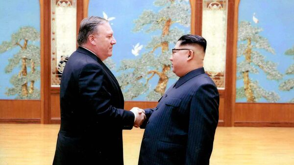 In this image released by the White House, then-CIA director Mike Pompeo shakes hands with North Korean leader Kim Jong Un in Pyongyang, North Korea, during a 2018 East weekend trip. - Sputnik International