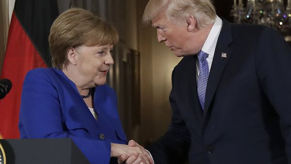 President Donald Trump shakes hands with German Chancellor Angela Merkel during a news conference in the East Room of the White House, Friday, April 27, 2018, in Washington. - Sputnik International