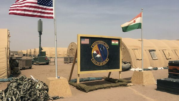 In this photo taken Monday, April 16, 2018, a U.S. and Niger flag are raised side by side at the base camp for air forces and other personnel supporting the construction of Niger Air Base 201 in Agadez, Niger.  - Sputnik International