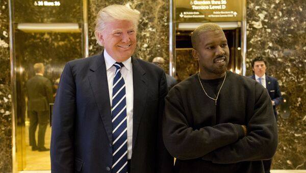 President-elect Donald Trump, left, and Kanye West pose for a picture in the lobby of Trump Tower in New York, Tuesday, Dec. 13, 2016 - Sputnik International