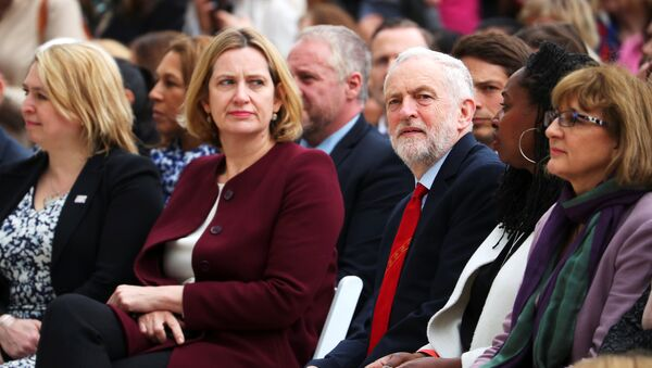 Britain's Home Secretary Amber Rudd sits next to Jeremy Corbyn, the leader of the Labour Party as they attend the unveiling of the statue of suffragist Millicent Fawcett on Parliament Square, in London, Britain, April 24, 2018 - Sputnik International