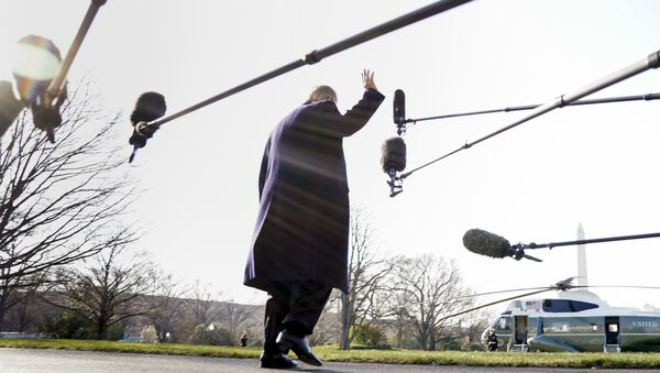 President Donald Trump waves before boarding Marine One on the South Lawn of the White House in Washington, Tuesday, March 13, 2018 - Sputnik International