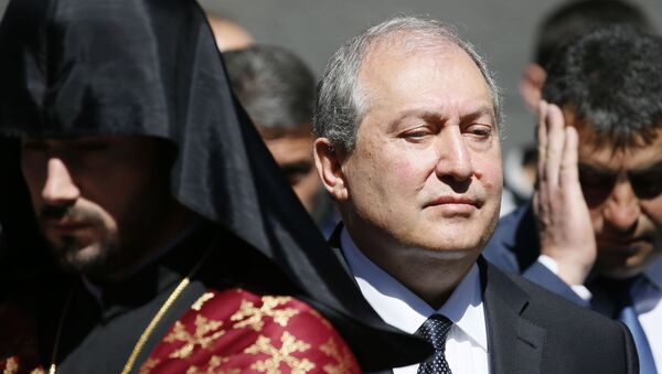 Armenian President Armen Sarkissian attends a wreath laying ceremony to commemorate the 103rd anniversary of mass killing of Armenians by Ottoman Turks, at the Tsitsernakaberd Memorial Complex in Yerevan, Armenia April 24, 2018 - Sputnik International