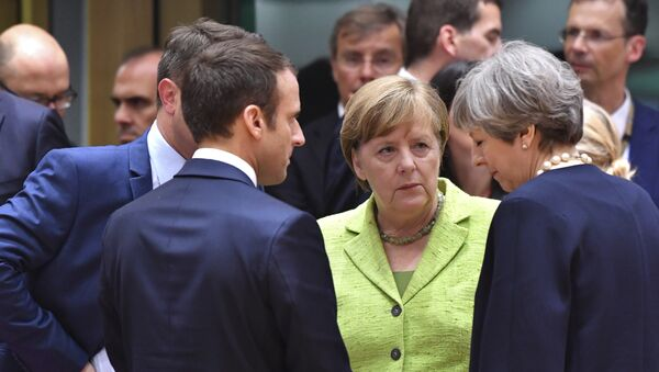 French President Emmanuel Macron, second left, speaks with German Chancellor Angela Merkel, center, and British Prime Minister Theresa May, right, during a round table meeting at an EU summit in Brussels on Thursday, June 22, 2017 - Sputnik International