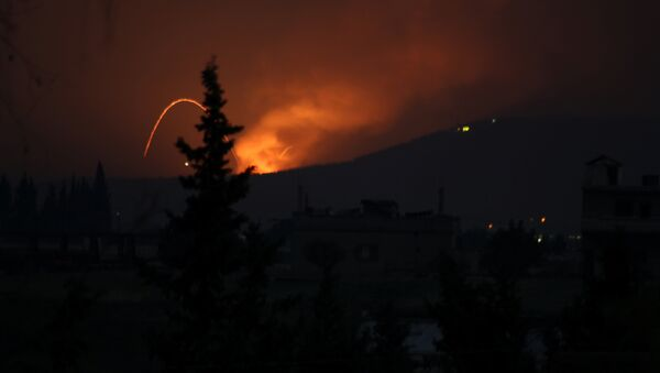 Fire and explosions are seen in what purported to be the Mountain 47 region, countryside south of Hama city, Syria, April 29, 2018 in this picture obtained from social media - Sputnik International