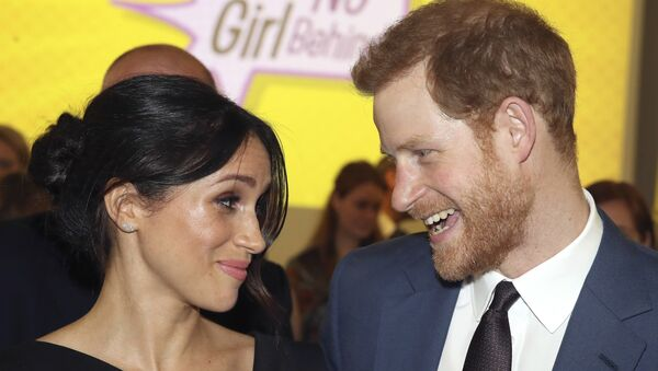 Britain's Prince Harry, left and Meghan Markle attend a women's empowerment reception at the Royal Aeronautical Society, during the Commonwealth Heads of Government Meeting, in London, Thursday April 19, 2018. - Sputnik International