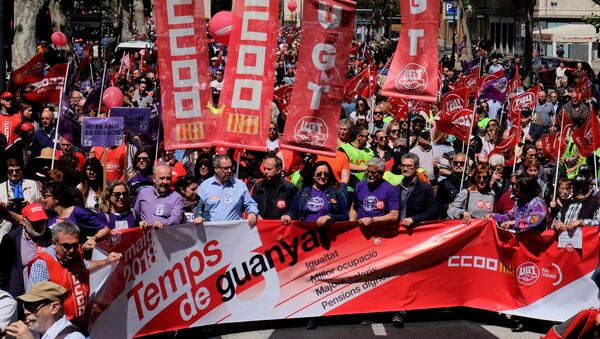 Demonstrators of Spain's leading trade unions CCOO and UGT march during May Day celebrations in Valencia - Sputnik International
