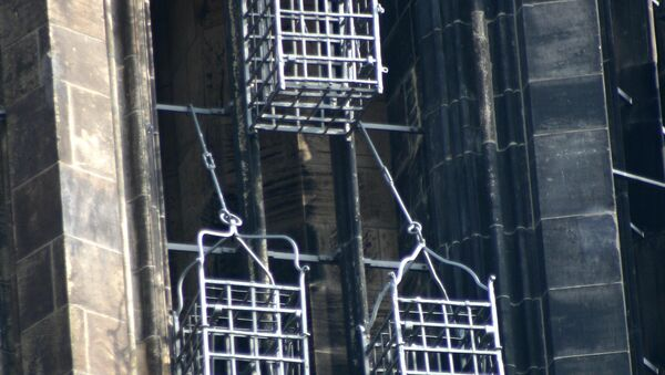Iron baskets that held the corpses of the leaders of the Münster Rebellion at the steeple of St. Lambert's Church - Sputnik International