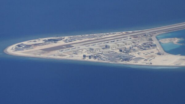 Chinese structures and an airstrip on the man-made Subi Reef at the Spratly group of islands in the South China Sea are seen from a Philippine Air Force C-130 transport plane of the Philippine Air Force, Friday, April 21, 2017 - Sputnik International