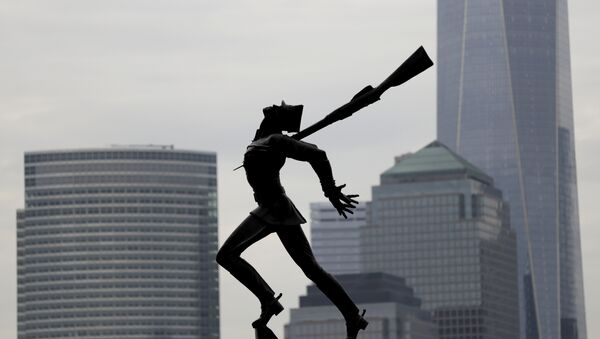 Buildings in Lower Manhattan provide a backdrop to a statue dedicated to the victims of the Katyn massacre of 1940, Friday, May 4, 2018, in Jersey City, N.J. - Sputnik International