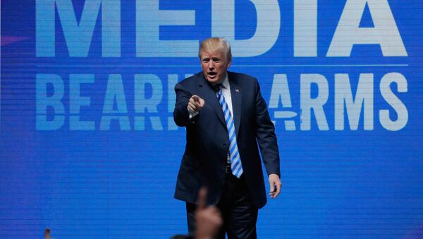 U.S. President Donald Trump gestures after speaking at a National Rifle Association (NRA) convention in Dallas, Texas, U.S. May 4, 2018 - Sputnik International
