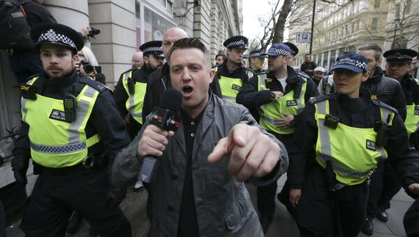 (File) Stephen Christopher Yaxley-Lennon, AKA Tommy Robinson, former leader of the right-wing EDL (English Defence League) is escorted away by police from a Britain First march and an English Defence League march in central London on April 4, 2017 - Sputnik International
