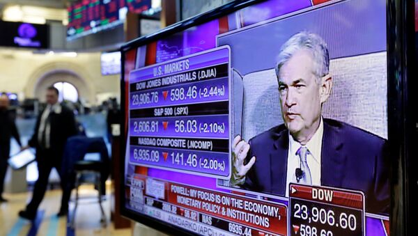 Federal Reserve Chairman Jerome Powell's speech at The Economic Club of Chicago, appears on a screen on the floor of the New York Stock Exchange, Friday, April 6, 2018 - Sputnik International