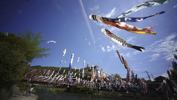 Colorful carp streamers flutter in the air over the Kawakami Gorge in Saga, Saga prefecture, southwestern Japan, Friday, April 13, 2018. The colorful streamers are hung to mark Children's Day on May 5, wishing children's healthy growth like carp that can swim up a waterfall - Sputnik International