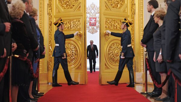 President-elect Vladimir Putin, center, enters St Andrew Hall of the Grand Kremlin Palace during the inauguration ceremony. File photo - Sputnik International