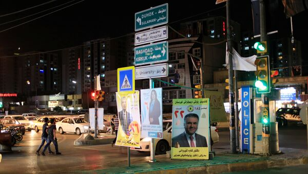 Campaign posters of a candidate are seen ahead of parliamentary election, in Erbil, Iraq, April 26, 2018 - Sputnik International