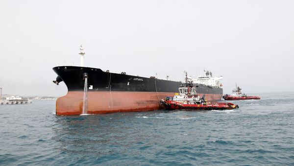 A picture taken on March 12, 2017, shows an Iranian tanker docking at the platform of the oil facility in the Khark Island, on the shore of the Gulf - Sputnik International