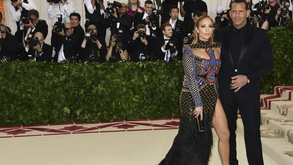 Jennifer Lopez, left, and Alex Rodriguez attend The Metropolitan Museum of Art's Costume Institute benefit gala celebrating the opening of the Heavenly Bodies: Fashion and the Catholic Imagination exhibition on Monday, May 7, 2018, in New York.  - Sputnik International