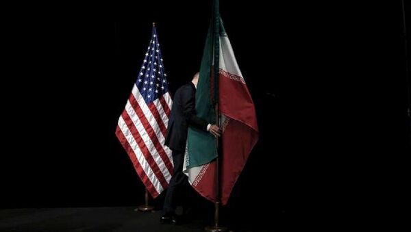 A staff member removes the Iranian flag from the stage after a group picture with foreign ministers and representatives of the U.S., Iran, China, Russia, Britain, Germany, France and the European Union during the Iran nuclear talks at the Vienna International Center in Vienna, Austria July 14, 2015 - Sputnik International