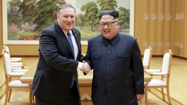 North Korean leader Kim Jong Un shakes hands with U.S. Secretary of State Mike Pompeo in this undated photo released on May 9, 2018 by North Korea's Korean Central News Agency (KCNA) in Pyongyang - Sputnik International