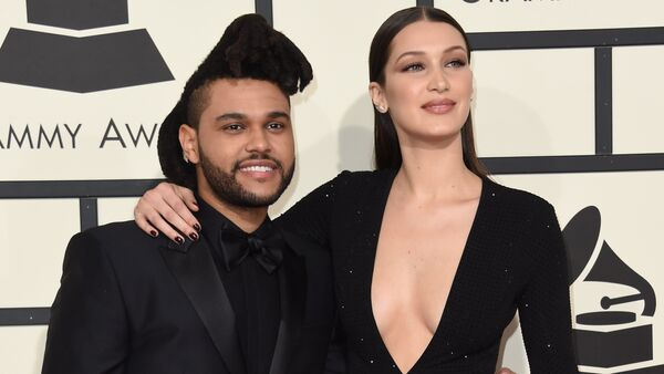 Bella Hadid and singer The Weeknd arrive on the red carpet for the 58th Annual Grammy music Awards in Los Angeles February 15, 2016 - Sputnik International