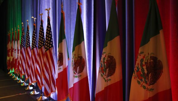 FILE - In this Aug. 16, 2017 file photo, the national flags of Canada, from left, the U.S. and Mexico, are lit by stage lights before a news conference, at the start of North American Free Trade Agreement renegotiations in Washington D.C. Mexico appears to be preparing for the worst as the fourth round of talks open in Washington D.C, Wednesday, Oct. 11, 2017 - Sputnik International