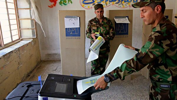 Iraqi soldiers prepare to cast their votes in early voting for Iraq's security forces, prisoners and hospital patients ahead of Saturday's national parliamentary elections, in Baghdad, Iraq, Thursday, May 10, 2018. - Sputnik International