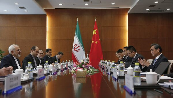 Chinese Foreign Minister Wang Yi, right, and Iranian Foreign Minister Mohammad Javad Zarif, left, attend a bilateral meeting Tuesday, Sept. 15, 2015 in Beijing, China - Sputnik International