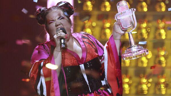 Netta from Israel celebrates after winning the Eurovision song contest in Lisbon, Portugal, Saturday, May 12, 2018 during the Eurovision Song Contest grand final. - Sputnik International