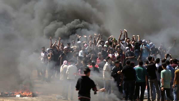 Palestinian demonstrators burn tyres near the Gaza-Israel border, east of Gaza City, as Palestinians readied for protests over the inauguration of the US embassy following its controversial move to Jerusalem on May 14, 0218 - Sputnik International