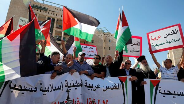 Palestinians, among them Adnan Husseini (3-rd R), the Palestinian Authority-appointed mayor of Jerusalem, participate in protest against the opening of the new U.S. embassy in Jerusalem, in Jerusalem May 14, 2018. Banner reads in Arabic Jerusalem Arab, Palestinian, Islamic and Christian and No to the Moving of the American Embassy. - Sputnik International
