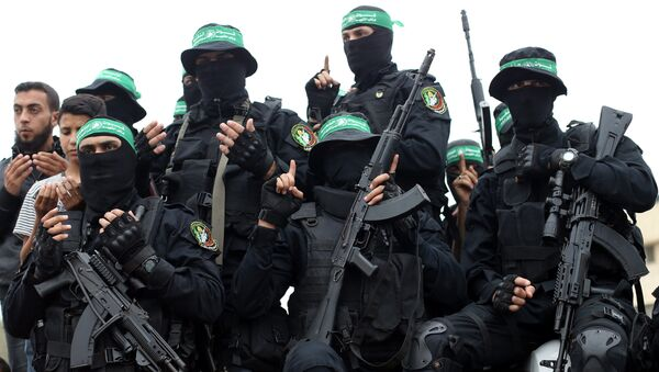 Palestinian Hamas militants attend the funeral of their comrades who were killed in an explosion, in the central Gaza Strip May 6, 2018 - Sputnik International
